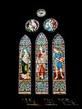 Ancient church window. Lead light stained glass decorated church window with light shining through stock photos