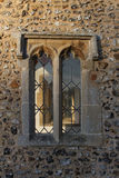 Ancient church window exterior, Burnham Market. Royalty Free Stock Photos