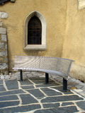 Ancient church window with modern bench Royalty Free Stock Image