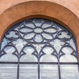 Ancient Church Window. Ornamented With Circles and Flower Royalty Free Stock Photo