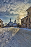 Ancient church in the winter. Against dawn Stock Photography