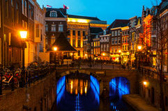 Ancient city center of Utrecht, Netherlands. Features many buildings from the Early Middle Ages. Illuminated Oudegracht area - a canal following the Rhine river Stock Photo