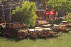 Ancient City Fenix in China. Historic Asian Scenery with Water Canals, Wooden Houses, Gondola Boats Stock Photos