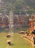 Ancient City Fenix in China. Historic Asian Scenery with Water Canals, Wooden Houses, Gondola Boats Royalty Free Stock Photography