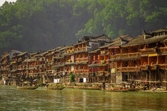Ancient City Fenix in China. Historic Asian Scenery with Water Canals, Wooden Houses, Gondola Boats Royalty Free Stock Photos