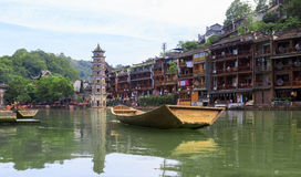 Ancient City Fenix in China. Historic Asian Scenery with Water Canals, Wooden Houses, Gondola Boats Stock Image