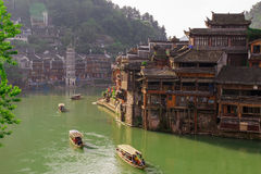 Ancient City Fenix in China. Historic Asian Scenery with Water Canals, Wooden Houses, Gondola Boats Stock Photo