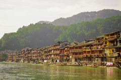 Ancient City Fenix in China. Historic Asian Scenery with Water Canals, Wooden Houses, Gondola Boats Royalty Free Stock Images