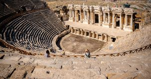 Ancient city of Hierapolis in Pamukkale, Turkey. People visit The ruins of Antique Theater in ancient Greek city Hierapolis, Pamukkale, Turkey.25 August 2017 royalty free stock photography