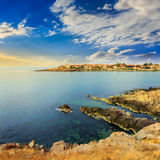 Ancient city on a rocky shore near sea at sunrise Royalty Free Stock Image
