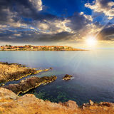 Ancient city on a rocky shore near sea at sunset Royalty Free Stock Photography