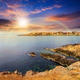 Ancient city on a rocky shore near sea at sunset Royalty Free Stock Photo
