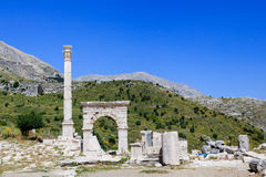 Marble arch and column at ancient city of Sagalassos. Ancient city Sagalassos ruins columns, sculpture and big stones Royalty Free Stock Image