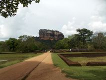 Ancient City of Sigiriya, Ceylon. Sigiriya Lion Rock is an ancient rock fortress located near the town of Dambulla in the Sri Lanka. The site was selected by royalty free stock image