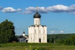 Church of the Intercession of the Holy Virgin on the Nerl River on the bright summer day. Ancient city Vladimir with suburbs is recognized as significant Royalty Free Stock Image