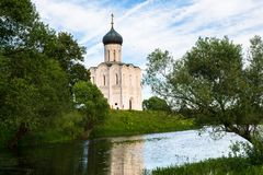Church of the Intercession of the Holy Virgin on the Nerl River on the bright summer day. Ancient city Vladimir with suburbs is recognized as significant Royalty Free Stock Photo
