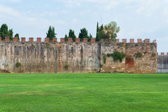 Ancient city wall of pisa. Italy in summer day Stock Photo