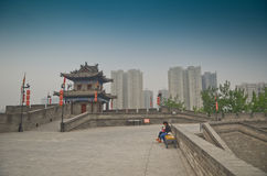 Ancient city walls of Xian, China. Ancient wall of Xian and modern buildings in the background Royalty Free Stock Photo