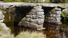 Ancient clapper bridge on Dartmoor in South West England Royalty Free Stock Photography
