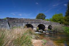 The ancient clapper bridge at Postbridges Stock Photography