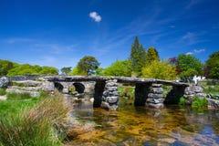 The ancient clapper bridge at Postbridges  Devon,England Stock Photo