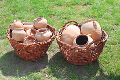 Ancient clay pots in basket Stock Image