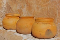 Ancient clay pots. Three old clay pots sit on the shelve in the storage room of the Tumacacori Mission Royalty Free Stock Photos