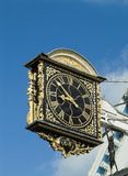 Ancient clock. Clock dating from 1683, highly decorated and carved. Guildford, England, UK Stock Photo