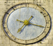 Ancient clock. Ancient clock with roman numbers and golden hands stock images