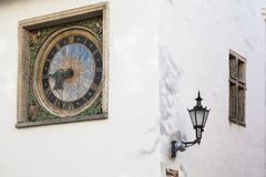 Ancient clock. On the wall of the Church of the Holy Spirit in Old Tallinn, master Christian Ackerman 1684 stock photo