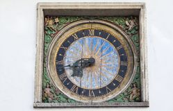 Ancient clock. On the wall of the Church of the Holy Spirit in Old Tallinn, master Christian Ackerman 1684 royalty free stock photography