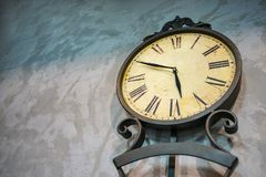 Ancient clock. On the wall plaster stock photos
