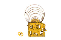 Ancient clock brass gears and steel mainspring isolated Royalty Free Stock Images