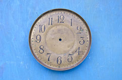 Ancient clock face dial on blue background Royalty Free Stock Photography
