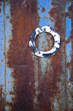 Ancient clock face on rusty metal tin Royalty Free Stock Photos