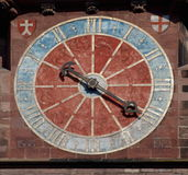 Ancient clock on the Freiburg Muenster cathedral Stock Image
