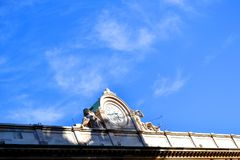 Ancient clock in front of Milan Duomo. Royalty Free Stock Images