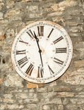 Ancient clock. A clock in an old farmhouse in Tuscany. Even if they are old will stop working but he can not stop time Royalty Free Stock Photos
