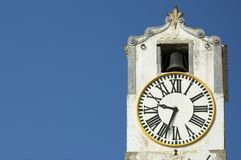 Ancient clock over blue sky with space for text Stock Images