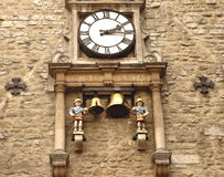 Ancient clock in Oxford. Ancient wall clock in the grounds of Oxford University stock images