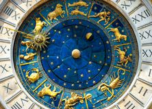 Ancient clock Torre dell`Orologio in Venice. Ancient clock Torre dell`Orologio on St Mark`s Square San Marco in Venice. Detail with clock face and astrological stock photo
