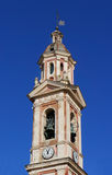 Ancient clock tower with blue sky. Stock Photo