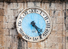 Ancient clock tower. Of central Saint Nicholas Church, Perast town, Montenegro royalty free stock photography