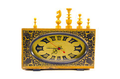 Ancient clock and vintage chess figures on white Royalty Free Stock Photos