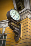 Ancient clock on the wall. In Saint Petersburg, Russia stock photography