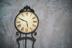 Ancient clock. On the wall plaster stock image