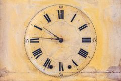 Ancient clock with roman numbers Royalty Free Stock Image