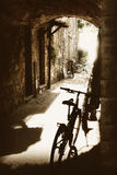 Ancient cobbled passageway with stone houses and bicycles Royalty Free Stock Photos