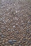 Ancient cobbles. Time-worn stone surface of English street Stock Photos