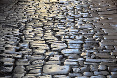Ancient cobblestone pavement Stock Image